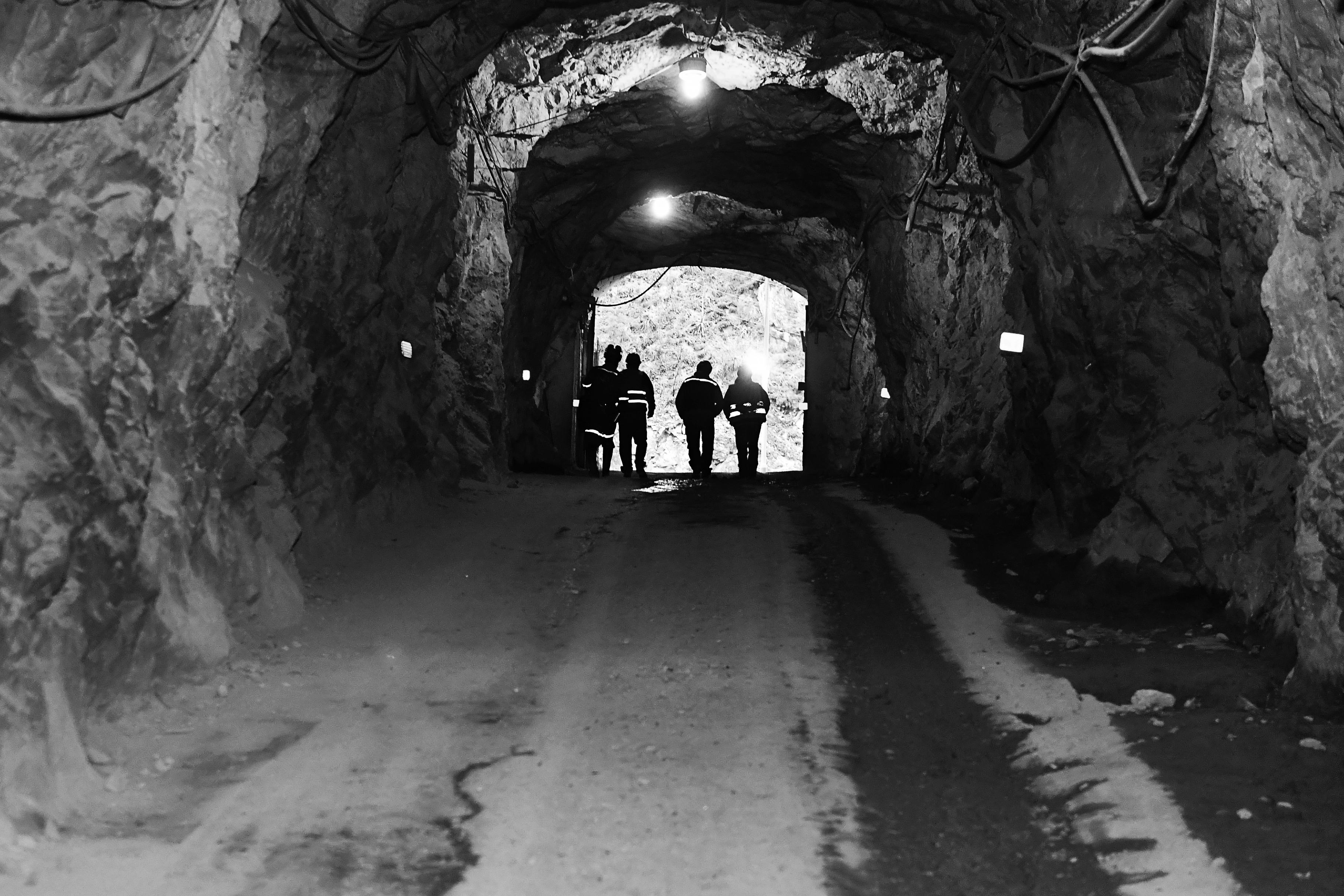 Black and White silhouettes in a mine tunne