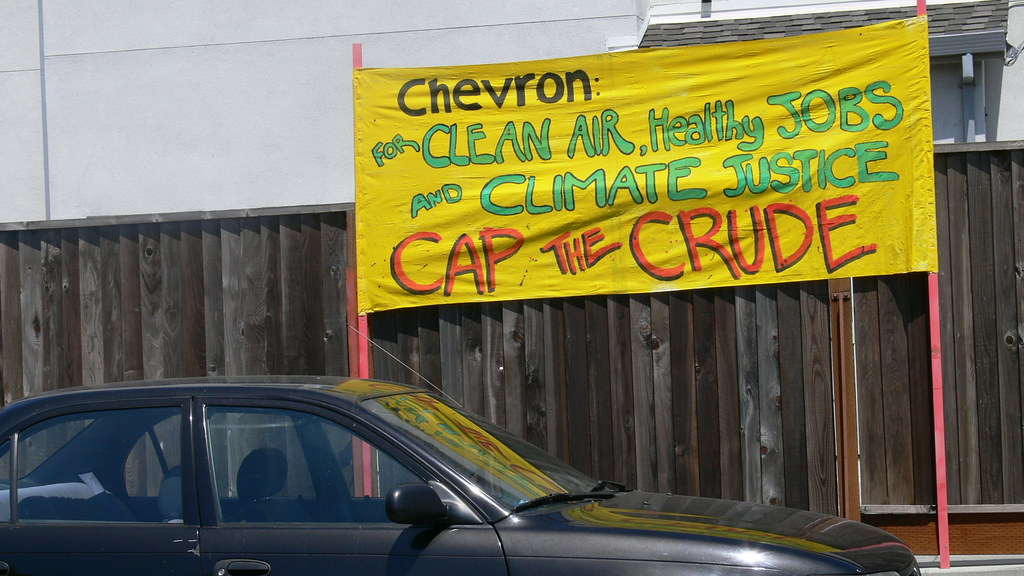 Signage that reads, 'Chevron: For Clean Air, Health Jobs and Climate Justice, Cap the Crude,' from a mass mobilization at the Chevron Oil Refinery in Richmond on August 15, 2009.