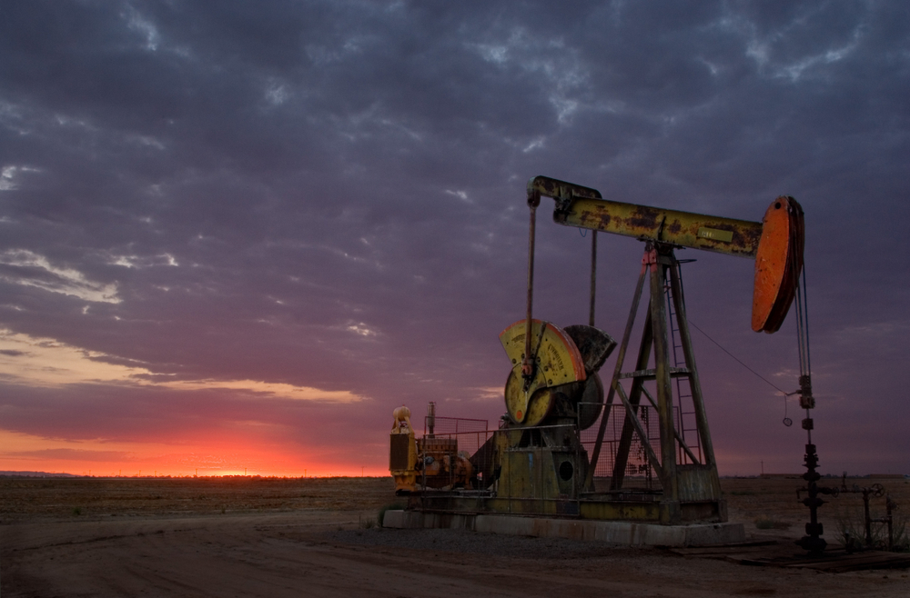 Oil well in the San Joaquin Valley of Central California at sunset.