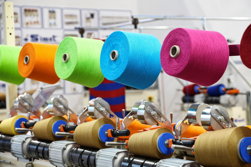 Textile fibers on roles in factory Milan