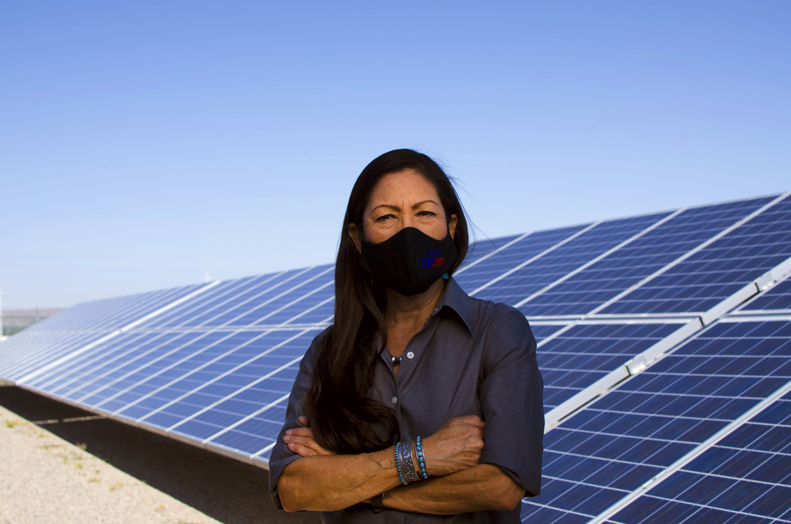 Deb Haaland with solar panels