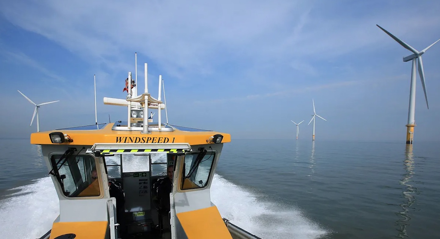 boat near wind turbines