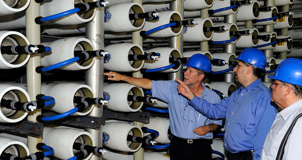 Men looking at pipes