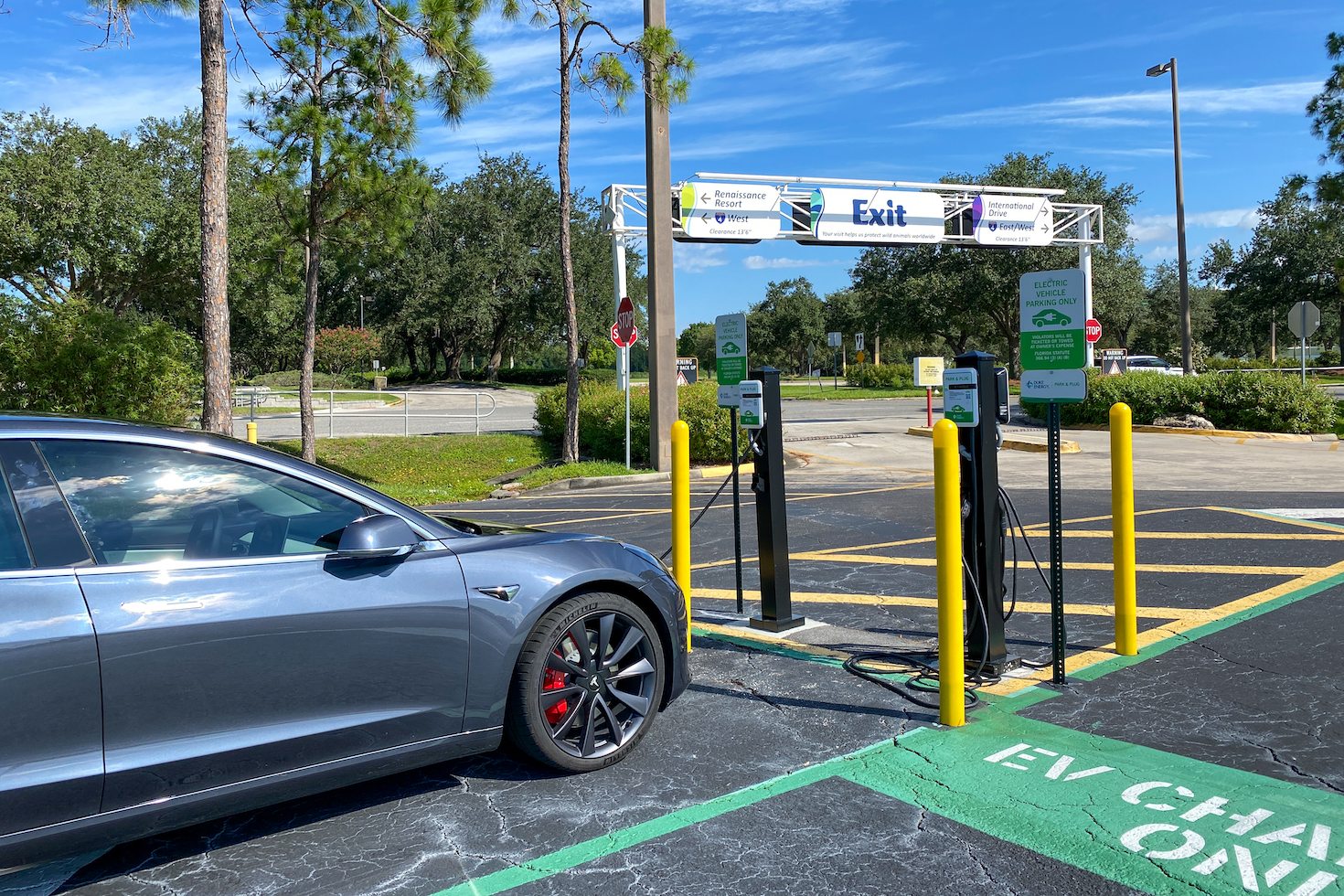 A Tesla parked in the EV parking spot in the parking lot at SeaWorld in Orlando, Florida.