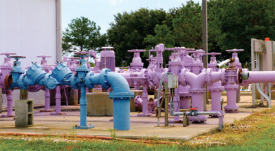 Purple pipes at Titusville, Fla.'s Blue Heron Water Reclamation Facility carry wastewater that's clean enough to use for irrigation and cooling systems. Photo by Rusty Clark (Flickr/Creative Commons).