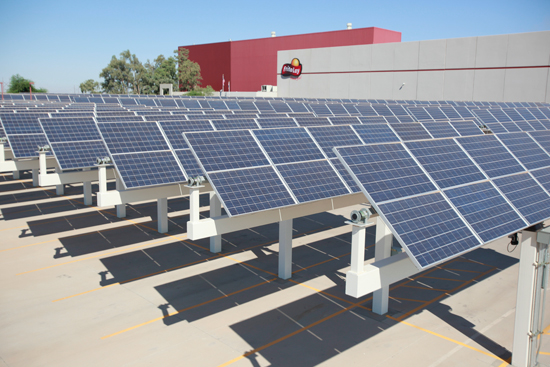 Solar panels shade employee cars while generating electricity for the factory.