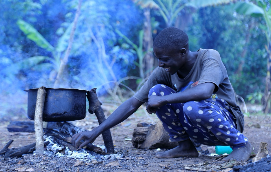 Cooking with biomass and basic materials in Kikumbi, Mityana District, Uganda.