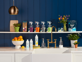An assortment of Grove Collaborative products on shelves and countertops