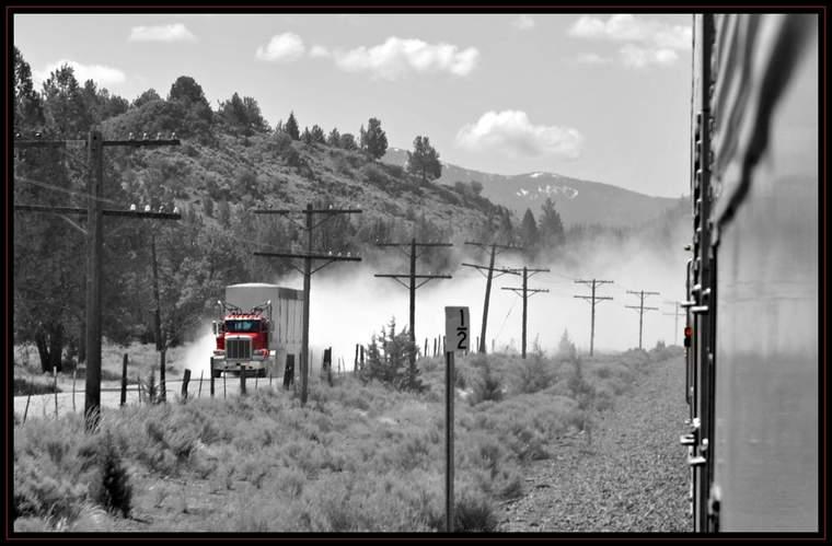 A big-rig approaches on a dirt road near Upper Klamath Lake, Oregon.