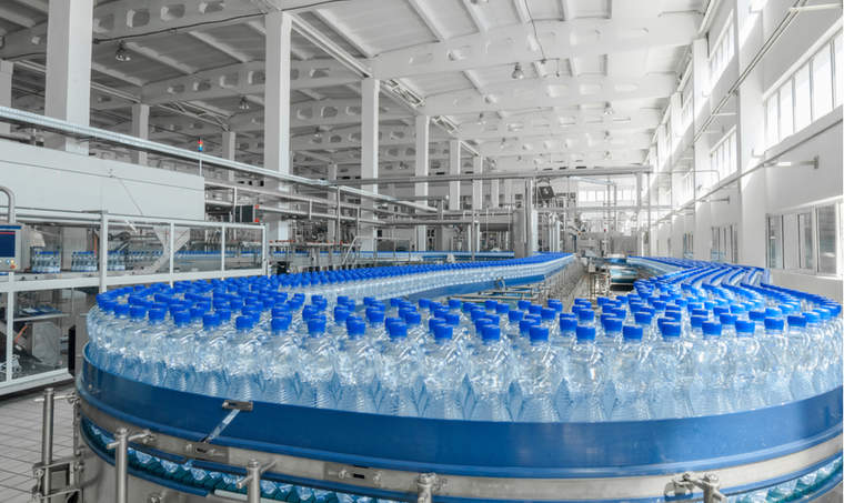 Production of plastic bottles on a conveyor belt in factory