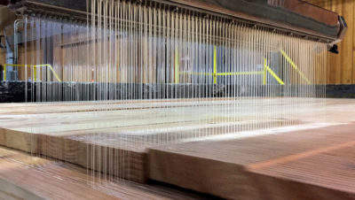 Glue is applied to create cross-laminated timber