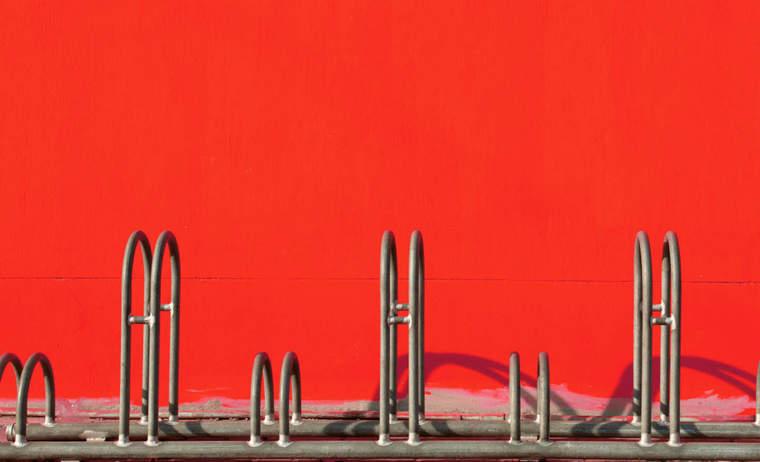 Bike rack against red wall