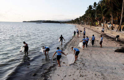 Police officers collect trash on Boracay Island
