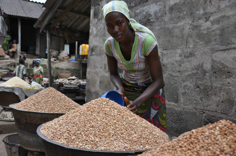 Woman selling cowpeas in Bodija market, Ibadan, Nigeria