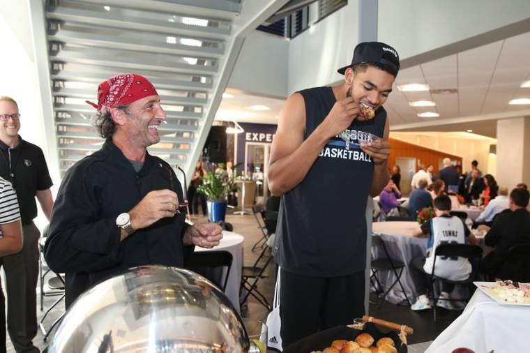 Karl-Anthony Towns of the Timberwolves samples some of David Fhima's clean, healthy, organic food offerings (Photo credit: David Sherman)