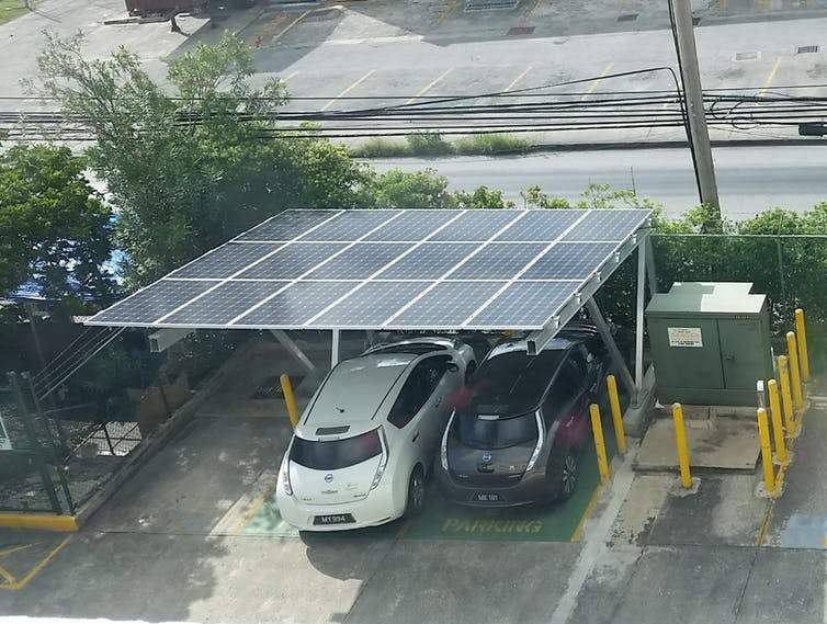 Solar panels power an electric car charging point in Bridgetown, Barbados