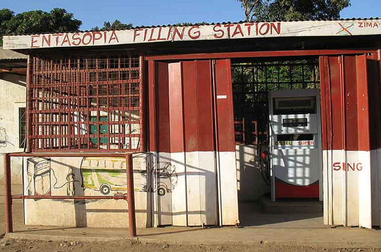 Nancy's Kasia's filling station is one of numerous businesses in Entasopia that have benefited from the new and reliable power from the microgrid.