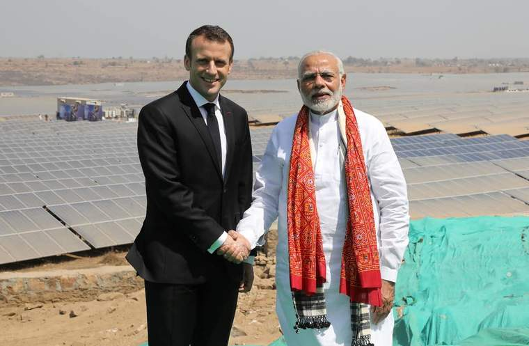 Indian Prime Minister Narendra Modi with France's Emanuel Macron at a new solar power plant in Mirzapur, India