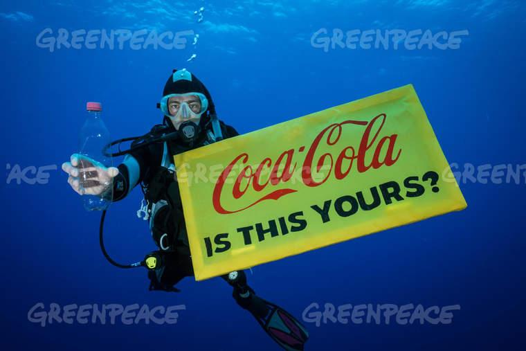 Diver with plastic Coke bottle