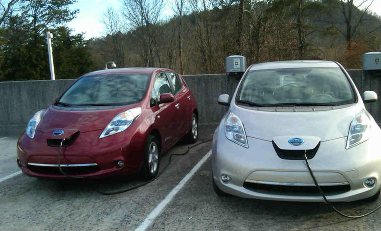 Two Nissan Leafs side by side