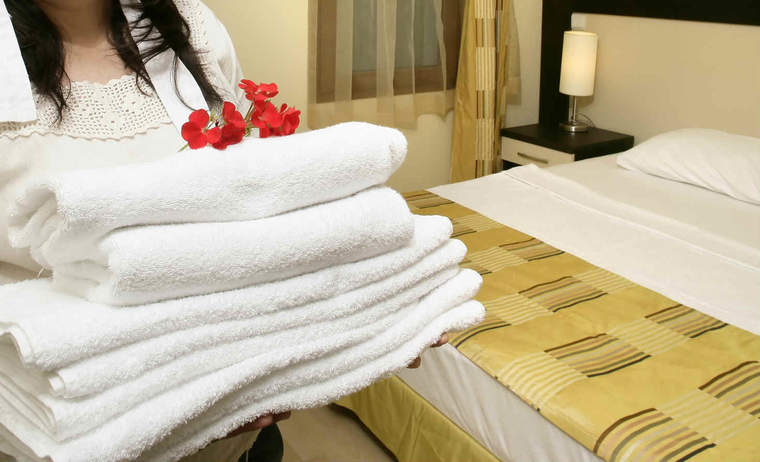 Person carrying hotel linens