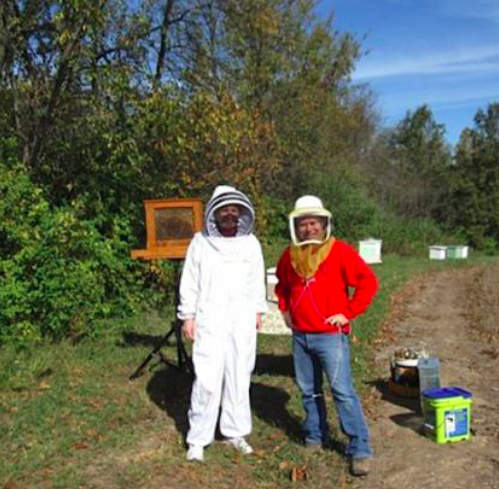 Maritz employees tend the honeybee colonies that, in turn, help maintain biodiverse productivity on the company's 174-acre campus.