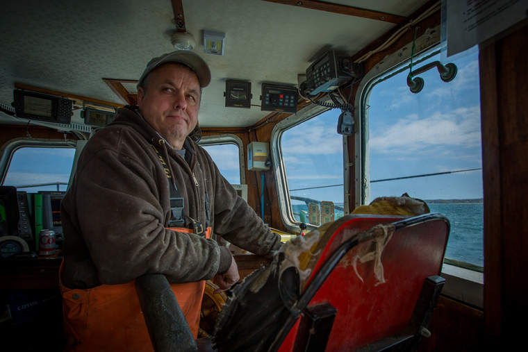 Sea captain monitoring his boat