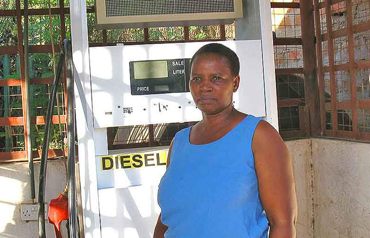 Nancy Kasia now uses solar power to pump fuel at the filling station she owns in Entasopia.