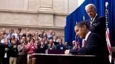 Barack Obama signing law