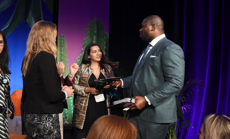 Ovie Mughelli talking to other conference attendees