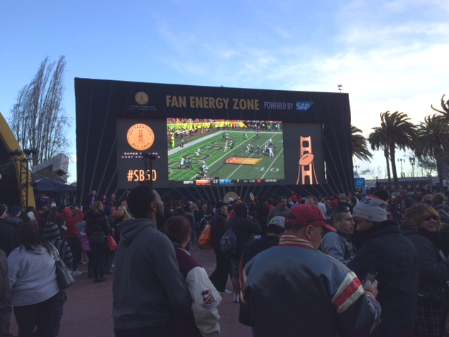 Fans watching Sunday's Pro Bowl in Super Bowl City on the big screen, sponsored by Bay Area Super Bowl 50 Host Committee sponsor SAP and its Fan Energy Zone, implying clean energy.