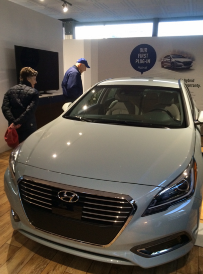 At the Super Bowl 50 Host Committee sponsor Hyundai's exhibit, the company displays its first Sonata Plug-In Hybrid.