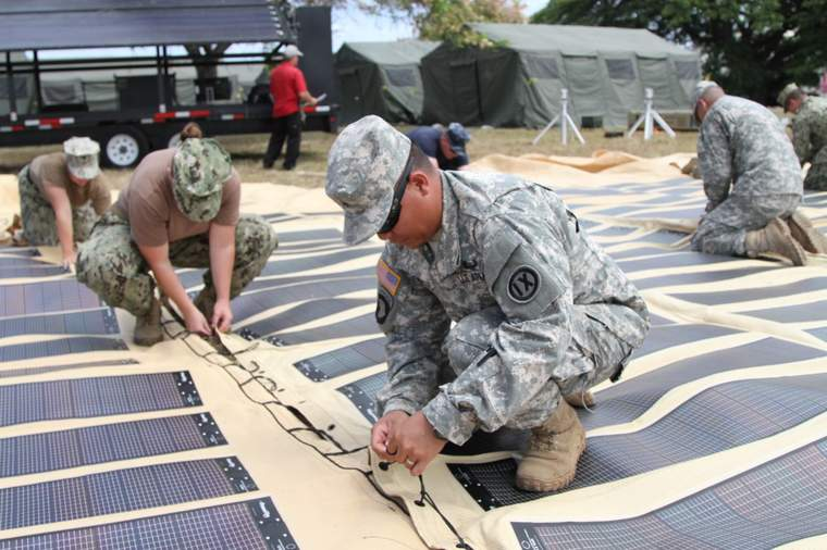 Soldiers assembling solar