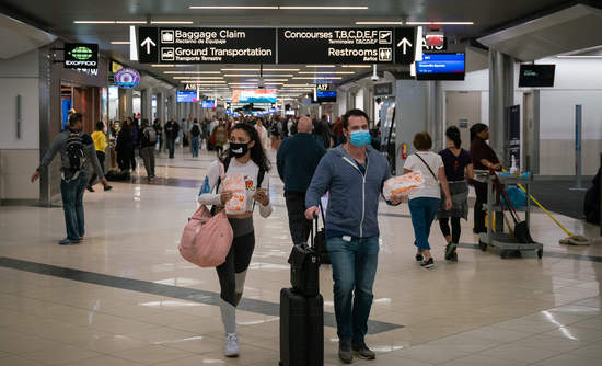 Flyers at Hartsfield-Jackson Atlanta International Airport wearing facemasks