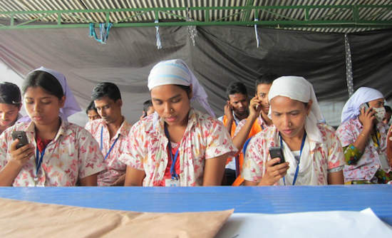 Bangladesh supply chain workers using LaborVoices technology
