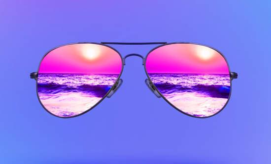 Sunglasses reflecting the beach