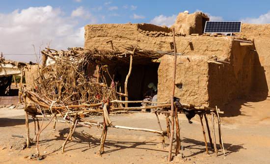 A Berber hut with a solar panel.