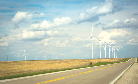 Falling costs to build wind farms will help Berkshire Hathaway's Iowa utility reach its 100 percent renewable energy goal.