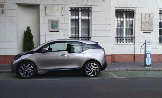 BMW i3 concept car is charging in the street