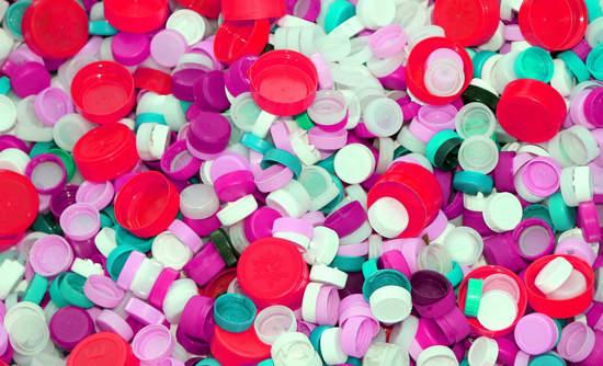 A pile of plastic bottle caps