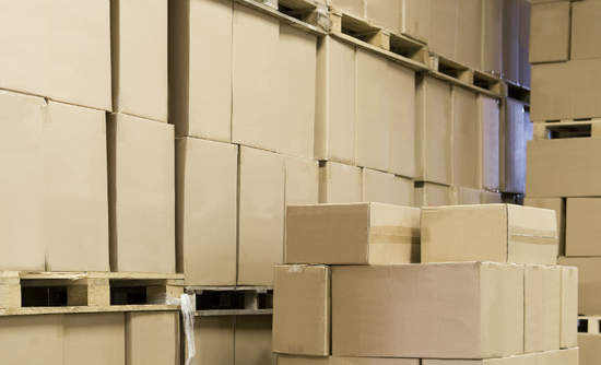 Tall stacks of boxes in a warehouse
