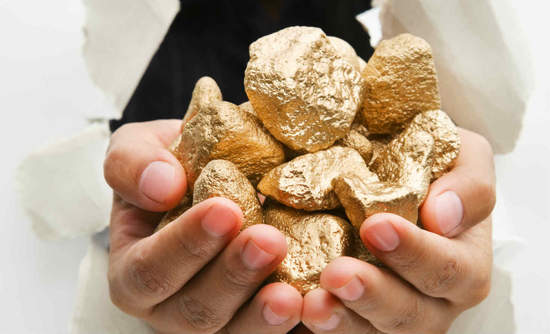 Hands breaking through walls with gold nuggets
