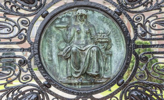 Bronze carving goddess on the entrance gate of the Peace Palace in The Hague, The Netherlands