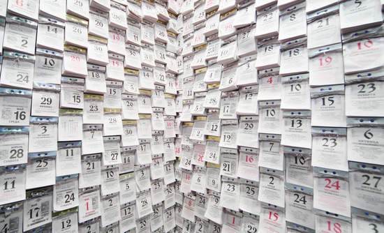 Tear-off calendars on a wall at the International Exhibition of Architecture and Design ARCH MOSCOW