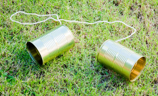 Tin can phone in the grass