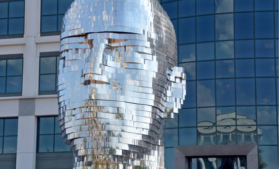 A water fountain called Metamorphosis, shaped like a man's mirrored head, in Charlotte, N.C.