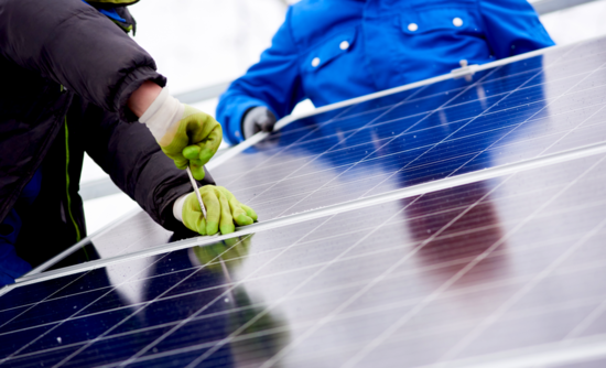 person working on solar panels