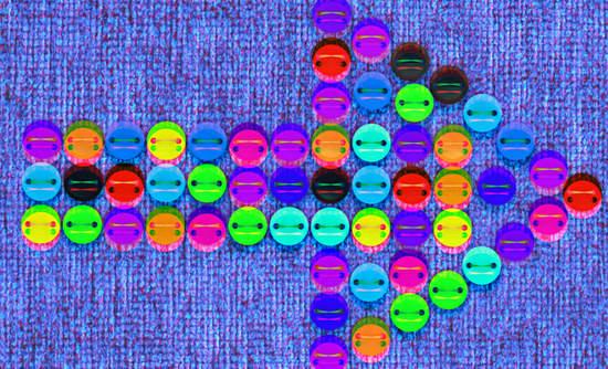Button of arrows on denim