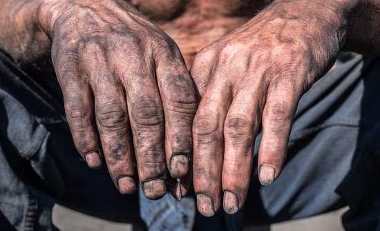 Hands of a coal miner