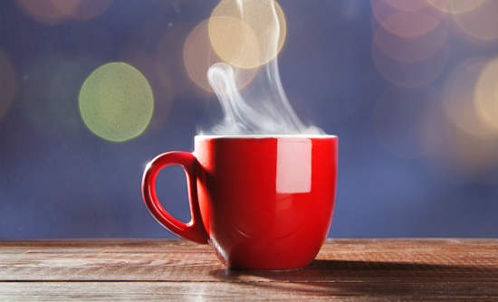 Steaming red coffee cup